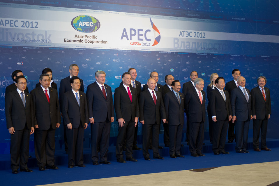 Secretary Clinton Poses for the APEC Leaders' Group Photo