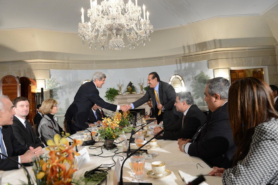 Secretary Kerry Shakes Hands With Qatari Prime Minister and Foreign Minister Sheikh Hamad bin Jassim bin Jabr Al-Thani
