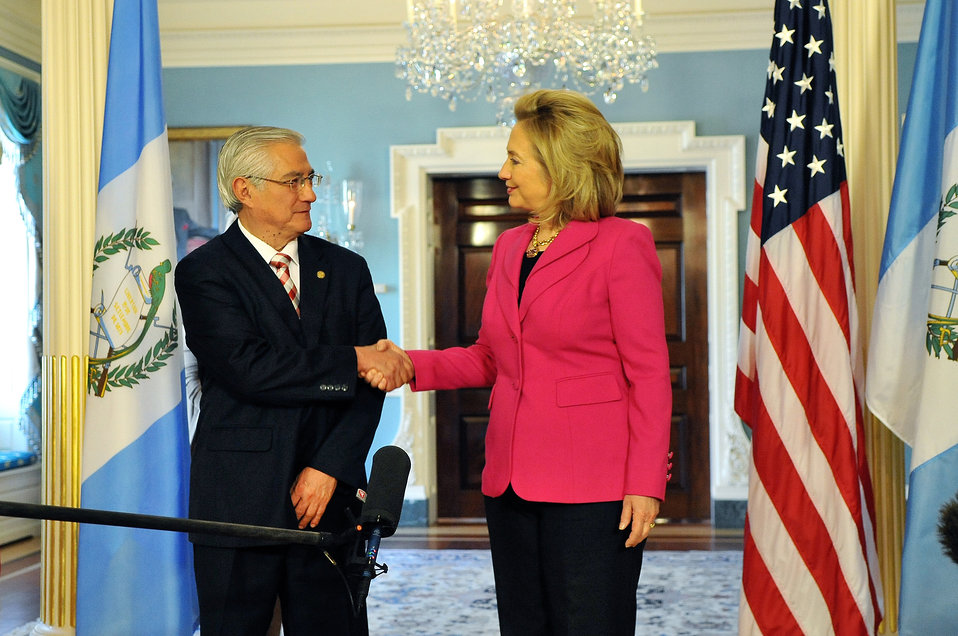 Secretary Clinton Shakes Hands With Guatemalan Foreign Minister Rodas