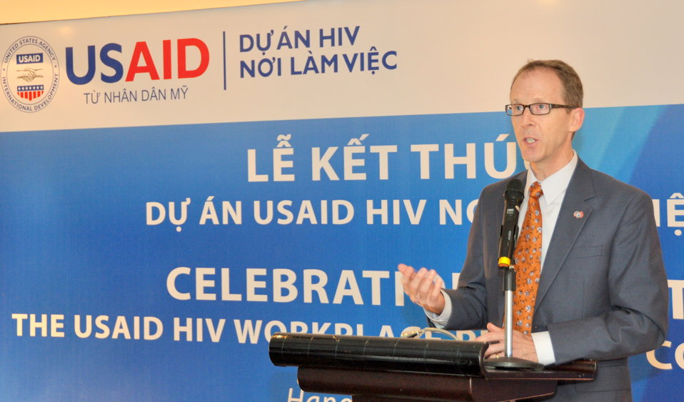 USAID Mission Director Joakim Parker addresses the completion event for the USAID HIV Workplace Project.