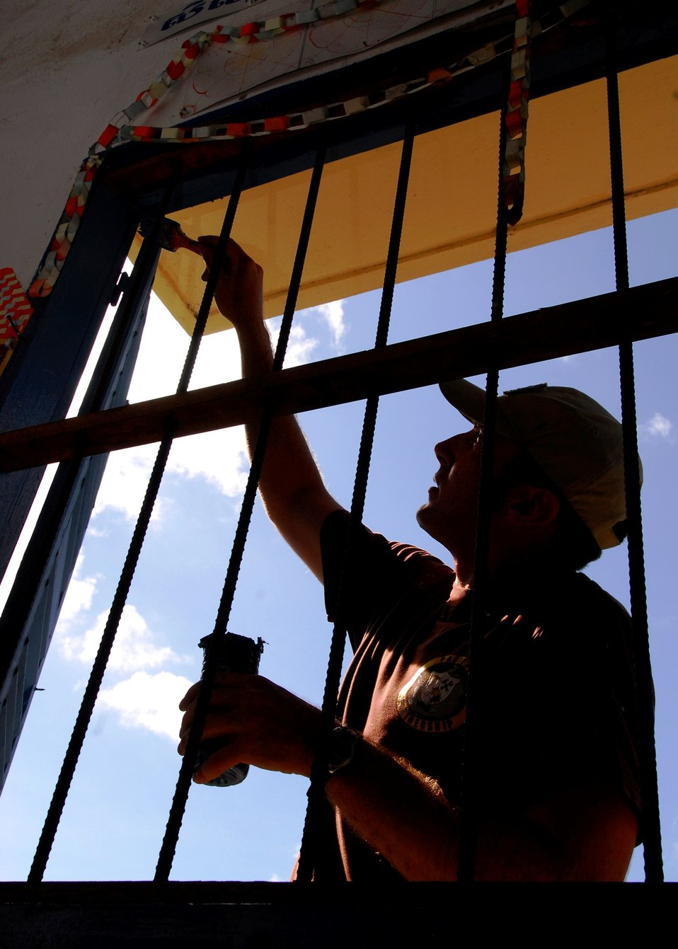 Australian Army Combat Engineer Lance Cpl. Sam Marshall Paints a Window Frame
