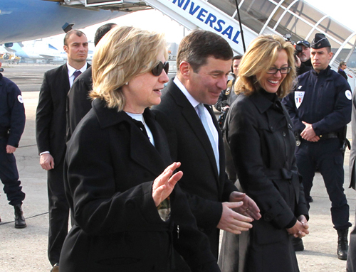 Secretary Clinton Is Greeted By Ambassador Rivkin and His Wife, Mrs. Tolson