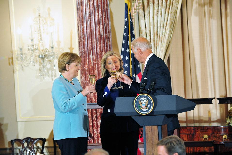 German Chancellor Merkel, Secretary Clinton, and Vice President Biden Toast the U.S.-Germany Partnership