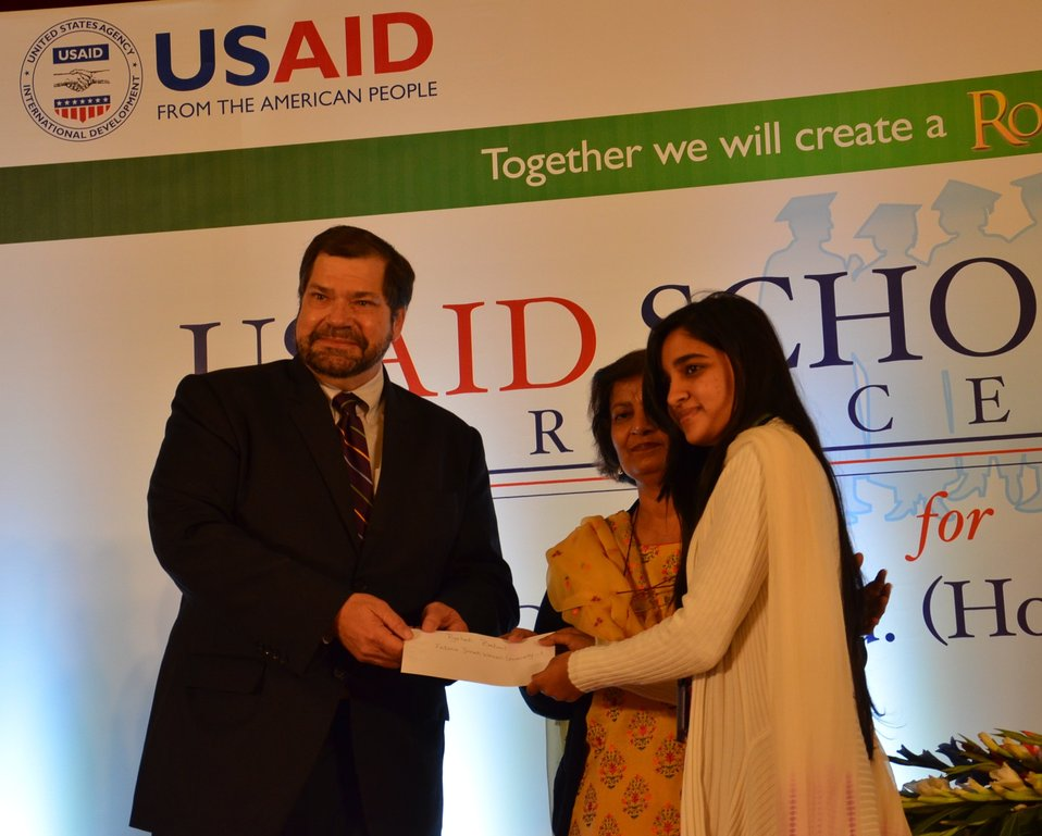 Mr. Bakken awarding USAID scholarship 2