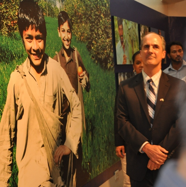 Provinicial Mission Director Punjab Ted Gehr and USAID team walking through the photos on display