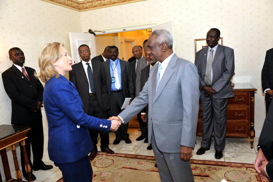 Secretary Clinton Shakes Hands With Sudanese Vice President Ali Osman Taha