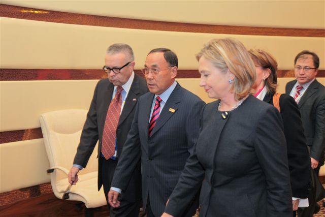 Secretary Clinton Walks With Kazakh Foreign Minister Saudabayev