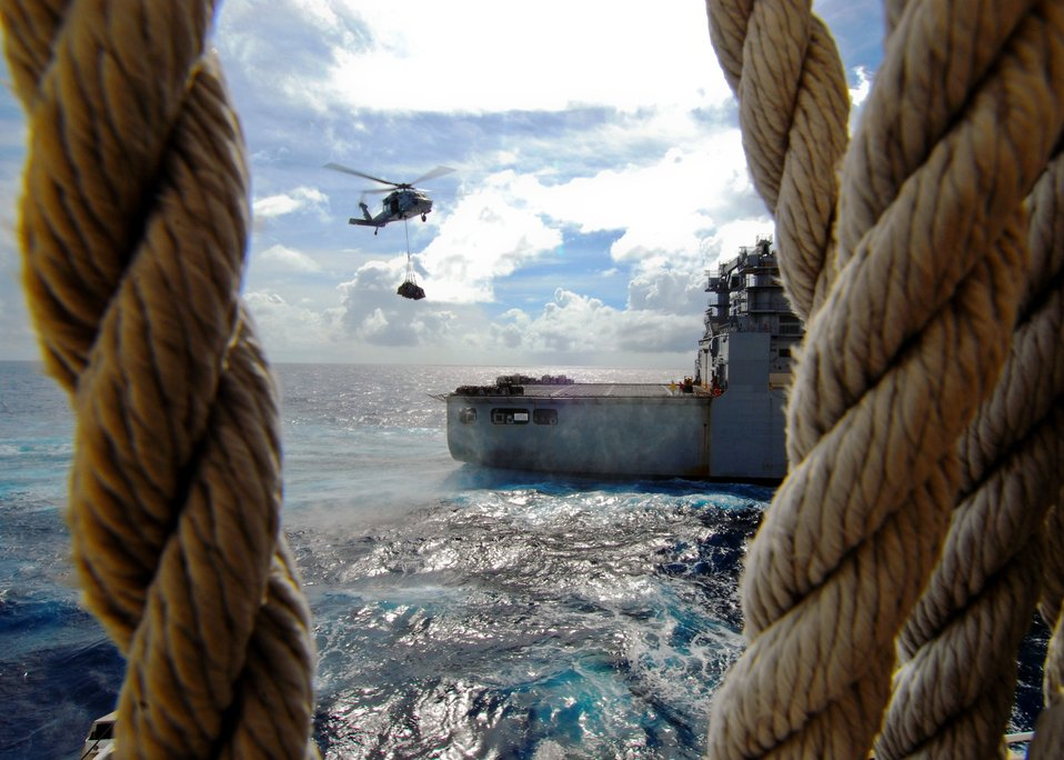 An MH-60S Knighthawk Helicopter Conducts a Vertical Replenishment (VERTREP) With Dry Cargo/ Ammunition Ship USNS Richard E. Byrd (T-AKE 4)