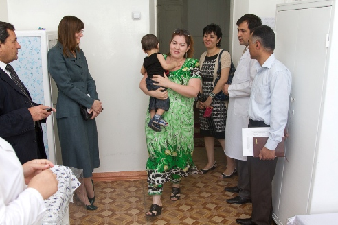 A Tajik Brings Her Child Into a Health Clinic