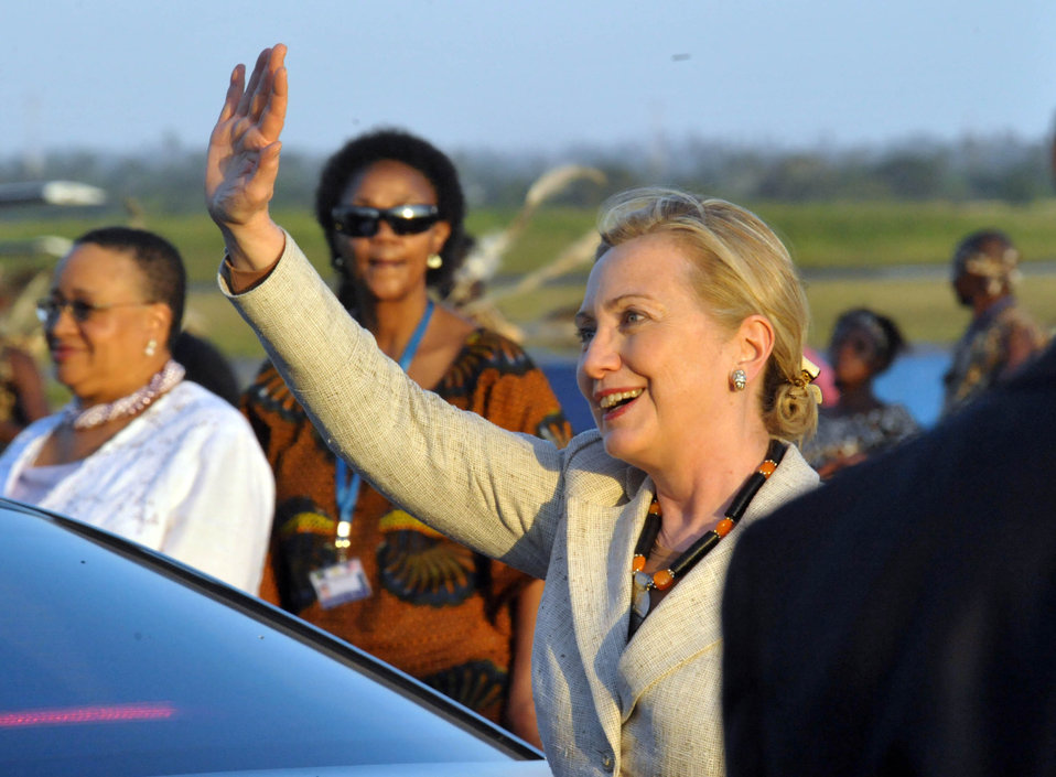 Secretary Clinton Waves Upon Her Arrival in Dar Es Salaam