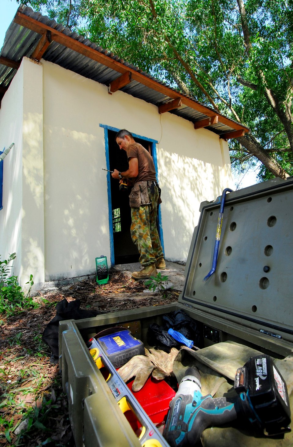 Australian Army Combat Engineer Sapper Bradley Hartnett Tightens His Drill Bit