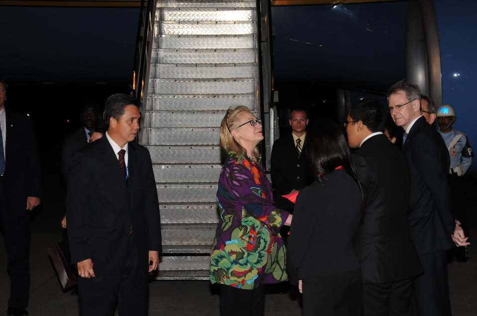 Secretary Clinton Is Greeted By Indonesian Director for Protocol Kandou, Indonesian foreign Ministry Protocol Liaisons Novita and Moniaga, and Ambassador Carden