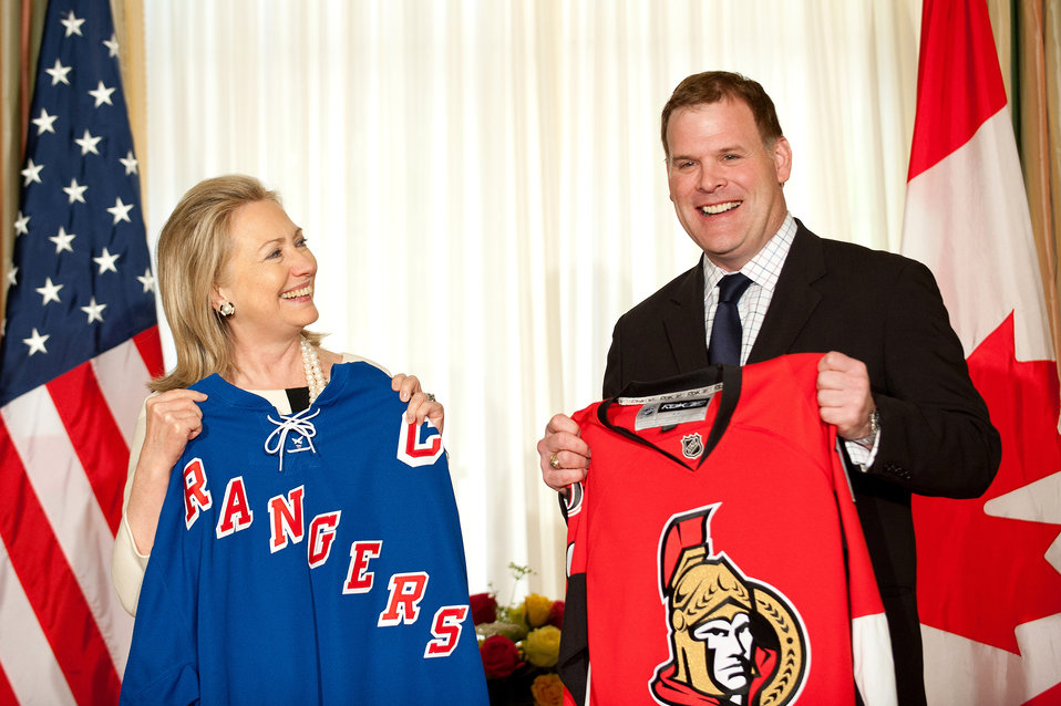 Secretary Clinton and Canadian Foreign Minister Baird Place a Friendly Hockey Bet