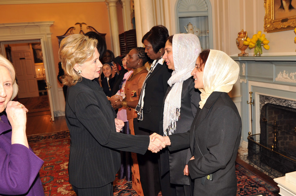 Secretary Clinton Shakes Hands With Honoree Shukria Asil