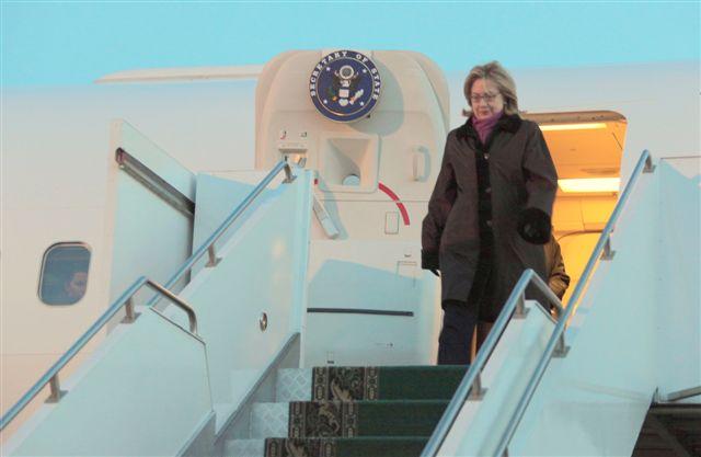 Secretary Clinton Deboards the Plane in Kazakhstan
