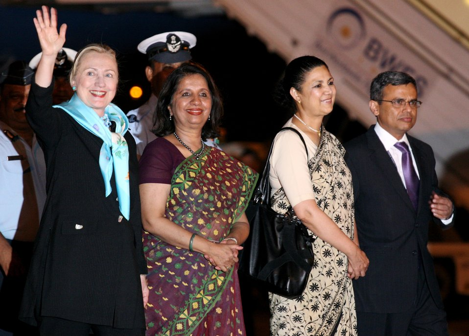 Secretary Clinton Waves Upon Arriving in New Delhi, India