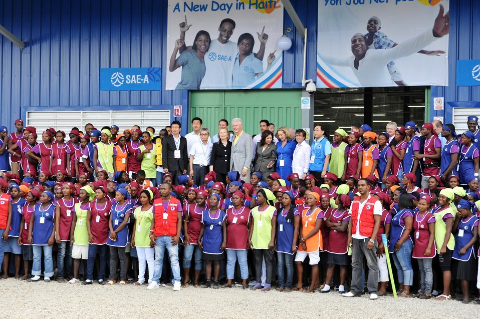 President Clinton and Secretary Clinton Pose for a Photo With Workers at Caracol Industrial Park