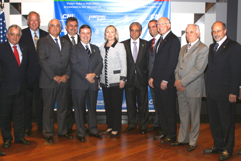 Secretary Clinton and Ambassador Shannon Pose for a Photo With Members of the Brazilian Business Community