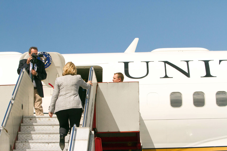 Secretary Clinton Boards the Plane To Depart Melbourne