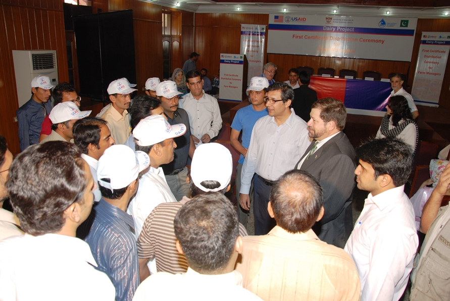 1 - USAID Mission Director Punjab Mr. Jeffrey Bakken interacting with the Dairy Project-trained dairy farm managers on October 4, 2012.