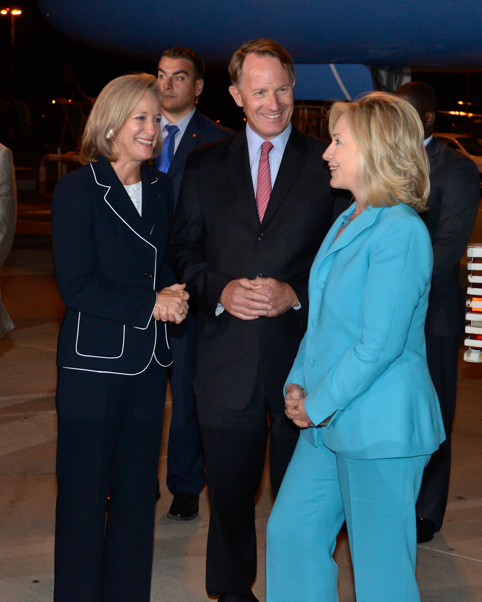 Secretary Clinton Is Greeted By Ambassador Smith and Mrs. Smith