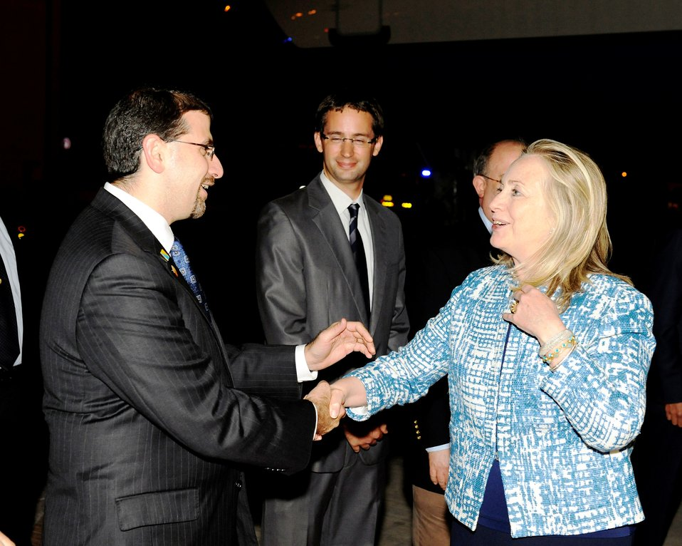 Secretary Clinton Is Greeted By Ambassador Shapiro