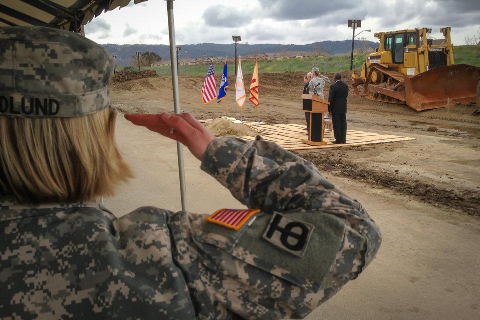 Chaplain (Capt.) Kerstin Hedlund salutes the flag