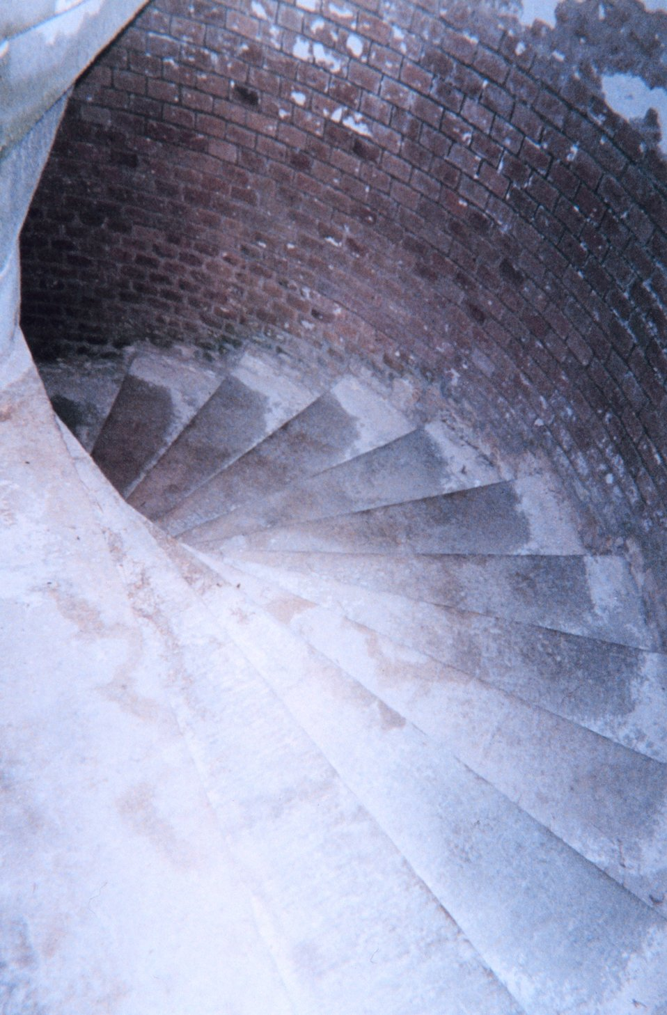 A spiral staircase leading down from the top of Fort Jefferson at Dry Tortugas National Park.