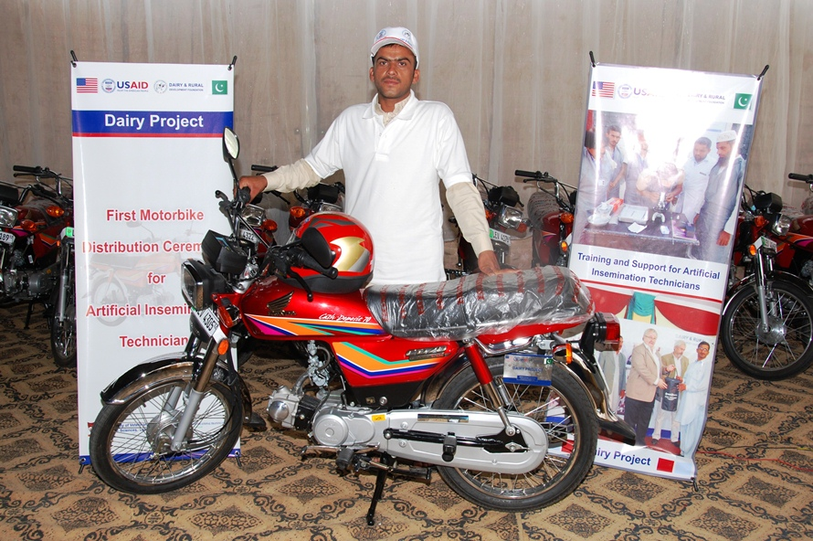 A successfull AI technician with his new motorcycle awarded by USAID Dairy Project 1