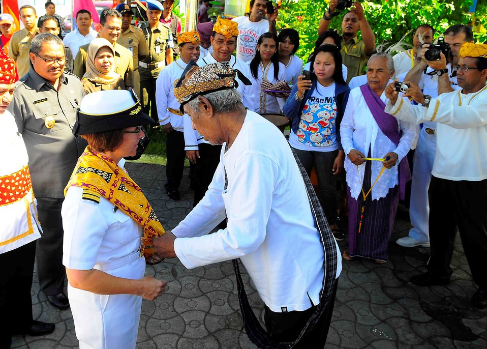 Pacific Partnership 2010 Commander Capt. Lisa M. Franchetti Receives a Cultural Garment from an Indonesian Official