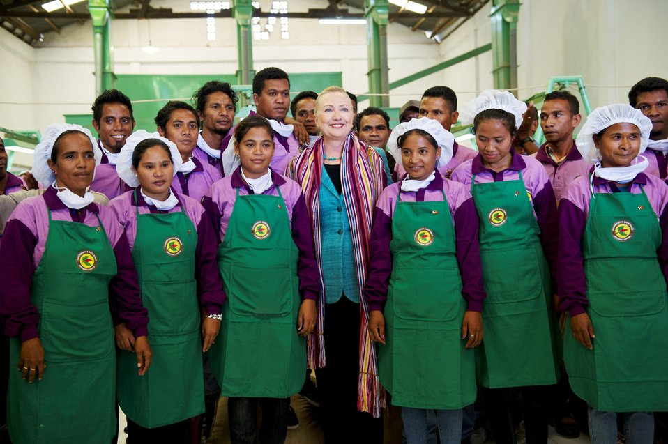 Secretary Clinton Smiles With Cooperativa Cafe Timor Workers