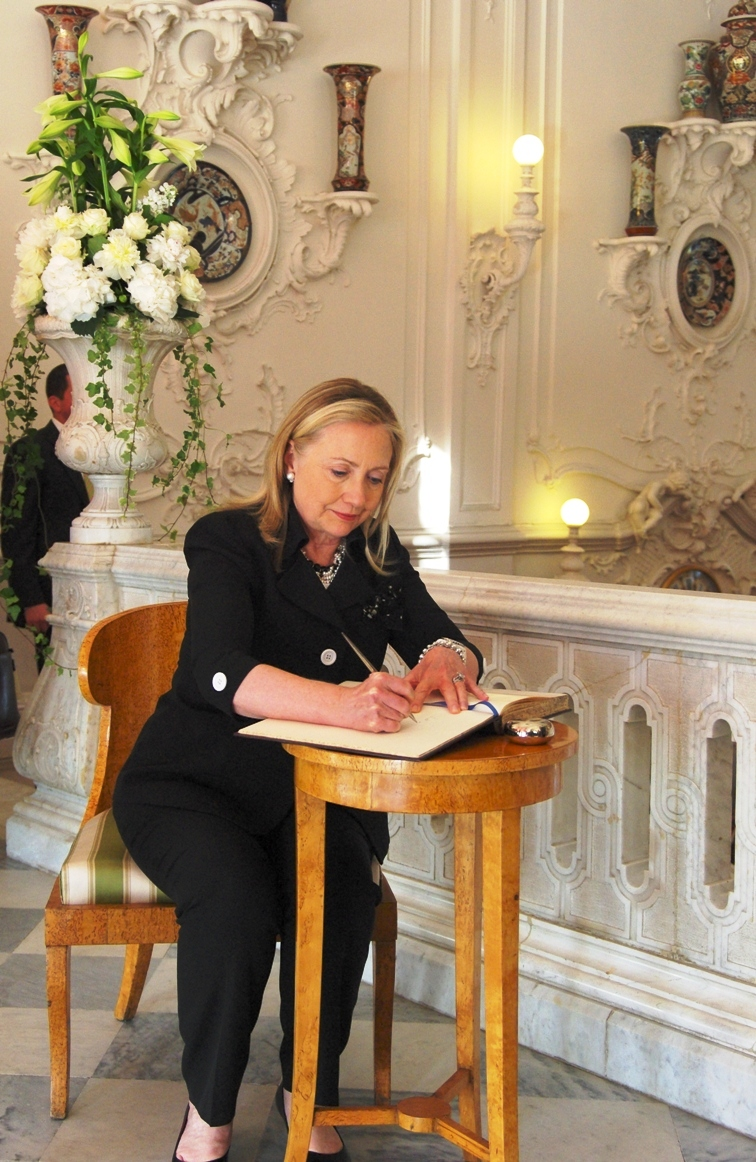 Secretary Clinton Signs the Guest Book