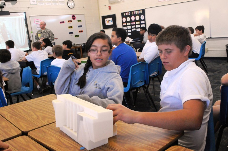 Students at St. John Notre Dame School in Folsom, Calif., practice opening the gates of a scale model of the Folsom Dam auxiliary spillway S