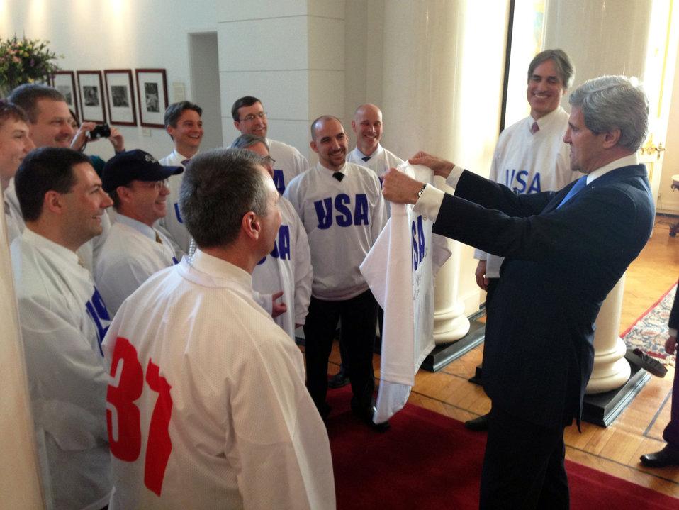Secretary Kerry Admires His New Hockey Jersey