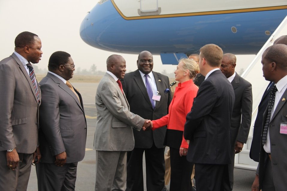 Secretary Clinton Is Greeted By Togolese Civil Service Minister Foli-Bazi