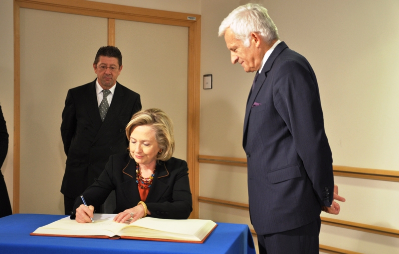 Secretary Clinton Signs the European Parliament President's Guest Book