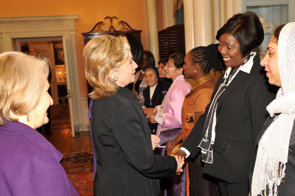 Secretary Clinton Shakes Hands With Honoree Sonia Pierre