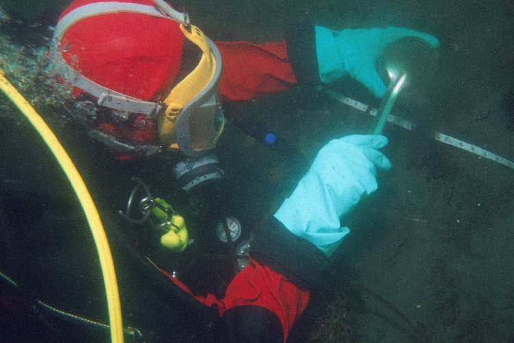 (Earlier photo) April 2011, EPA Diver collects sediment sample Wycoff Superfund Site
