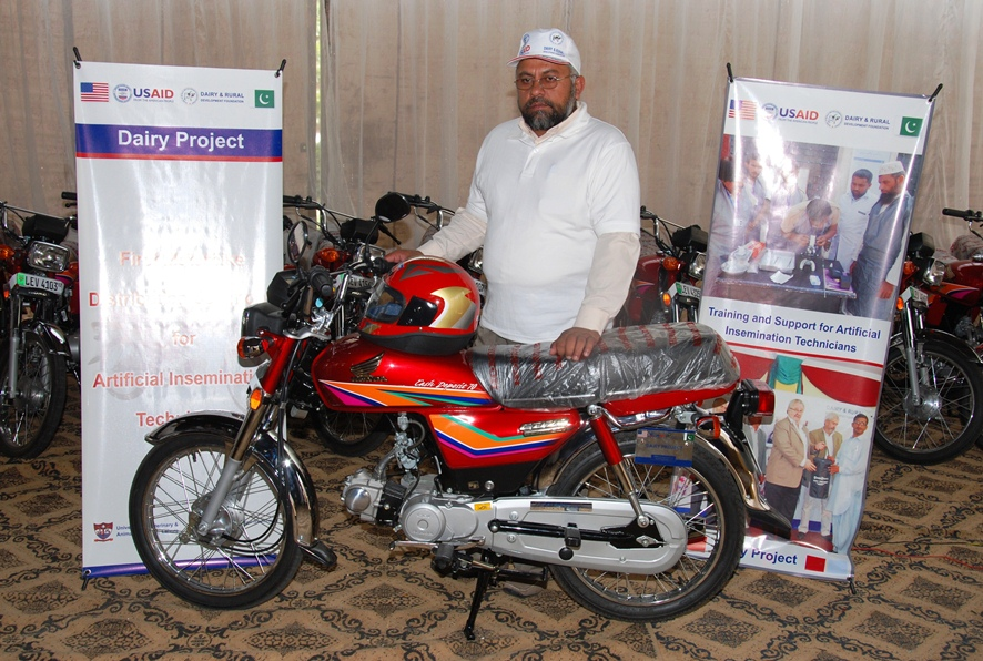 A successfull AI technician with his new motorcycle awarded by USAID Dairy Project4