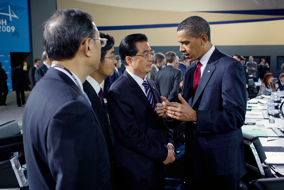 President Barack Obama Talks With Chinese President Hu Jintao During G-20