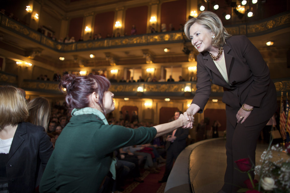 Secretary Clinton Shakes Hands With a Student