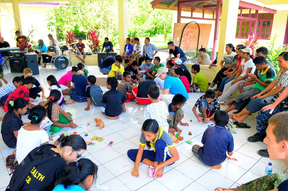 Sailors Interact With Indonesian Children