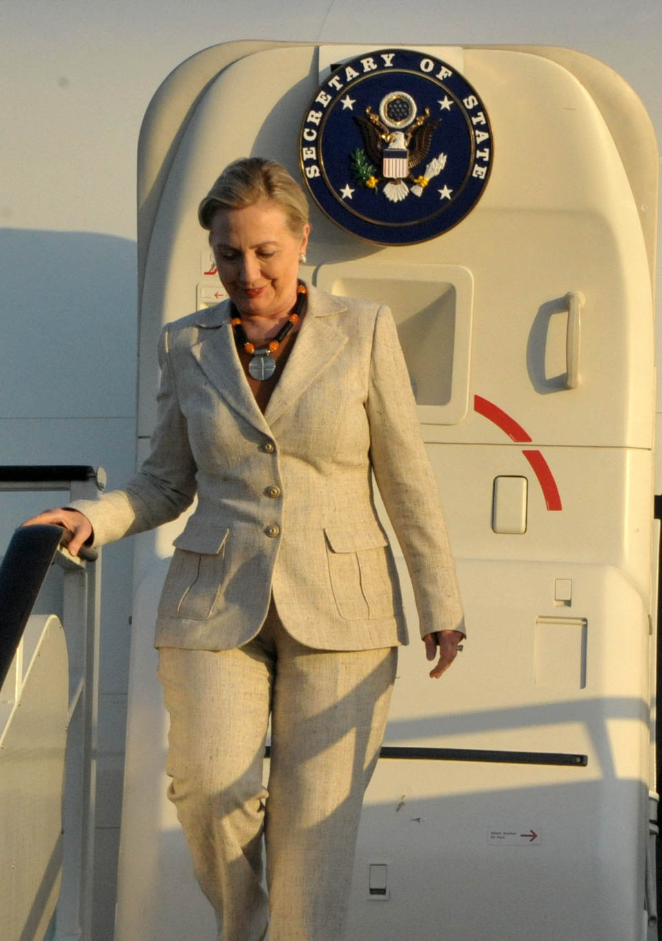 Secretary Clinton Steps Off the Plane