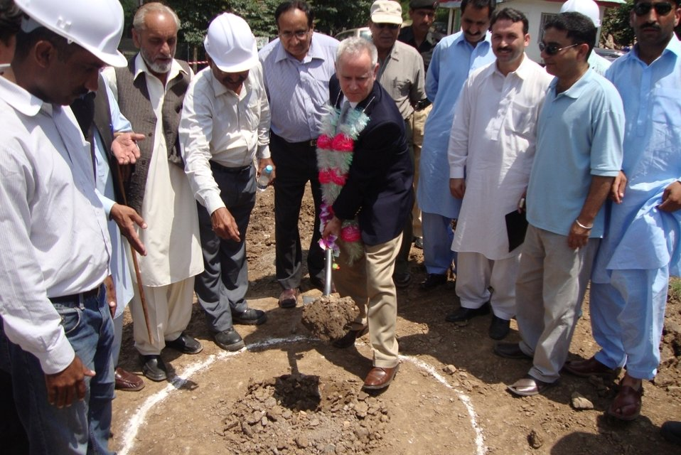 Ross Hagan, Deputy Director of USAID's Infrastructure Office, breaks ground at Dhikot Hospital