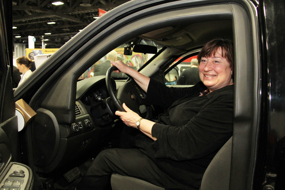 Under Secretary Novelli Sits Behind the Wheel of a Diplomatic Security Armored Vehicle
