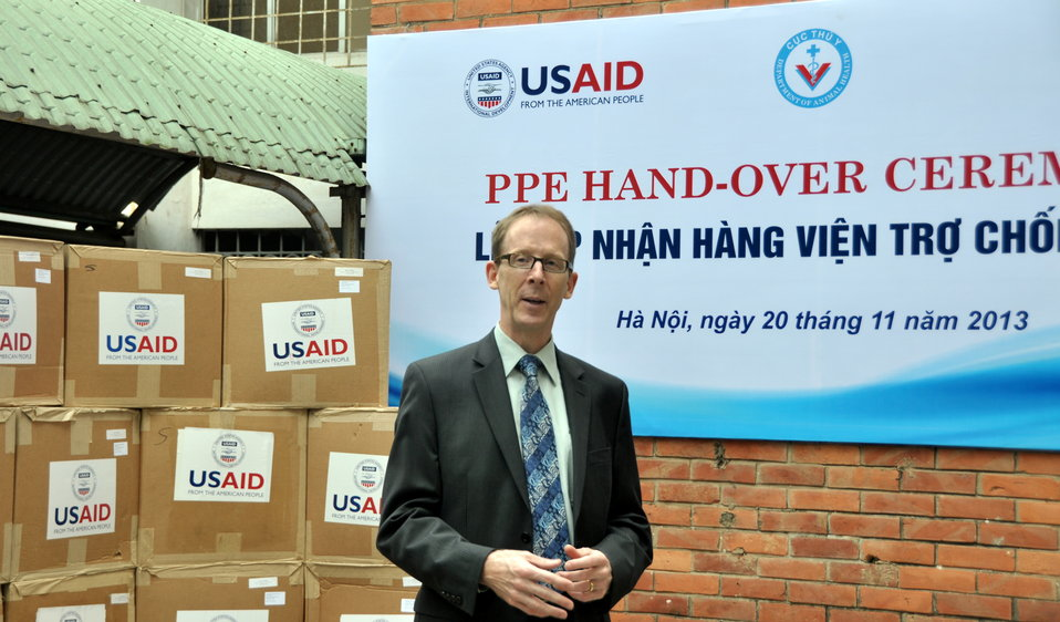 USAID Mission Director Joakim Parker speaks at the personal protective equipment handover ceremony.