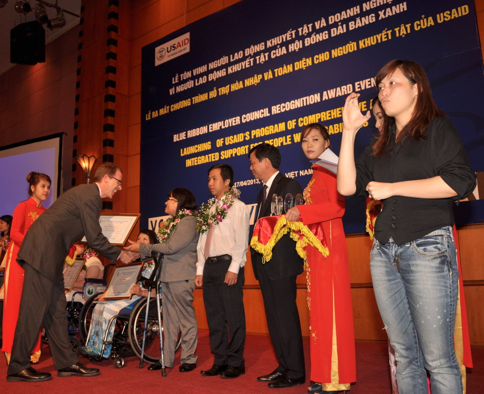 USAID Mission Director Joakim Parker awards employees with disabilities