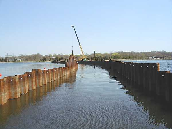 2001, EPA and NSTAR begin to relocate power cables across harbor