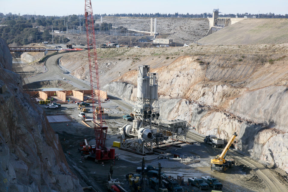 Concrete mixing equipment moves into the Folsom Dam auxiliary spillway