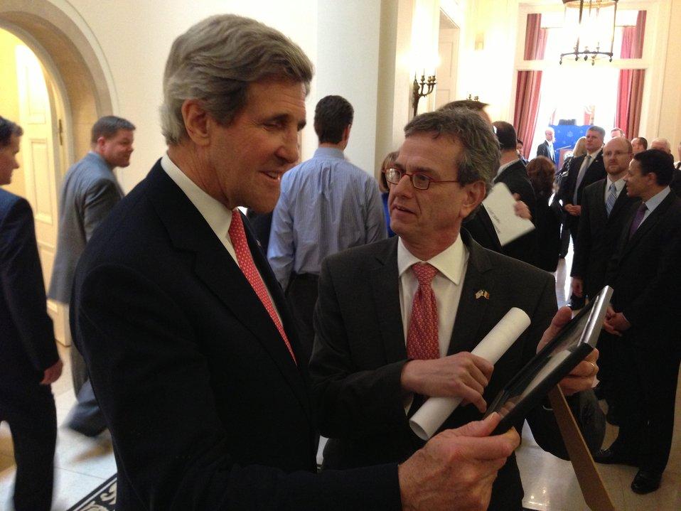 Ambassador Gutman Shows Secretary Kerry a Photo
